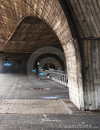 Barclays bicycle under a bridge in London, UK Editorial Photography