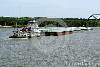 Barco del tirón y lancha a remolque del grano