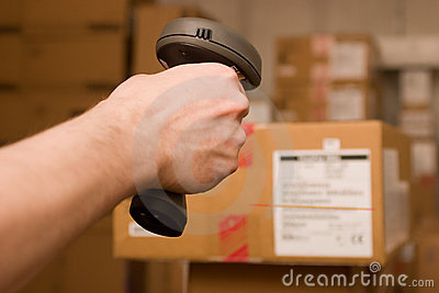 Barcode scaner in hands for a man