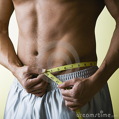 Free Bare Chested Man Measuring Wai Royalty Free Stock Photography - 3523537