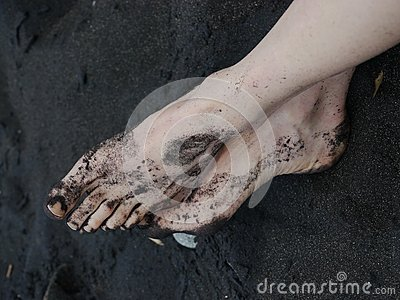 Bare feet black sand