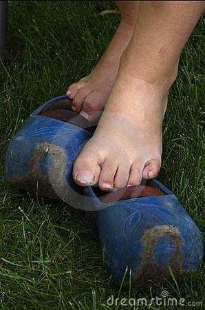Bare feet on blue wooden shoes