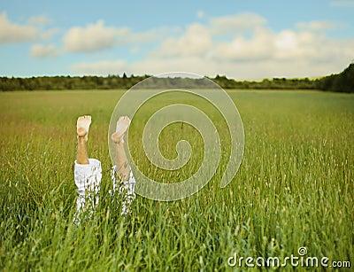 Bare feet from green grass