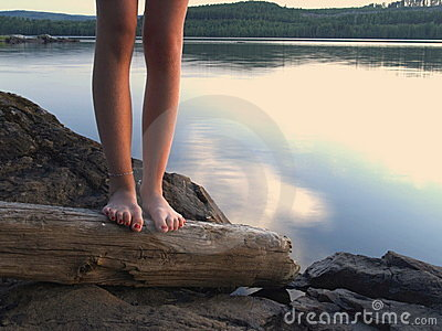Bare feet by a lake