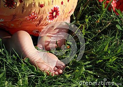 Bare feet of a little girl