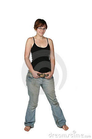 Bare foot young woman in faded jeans