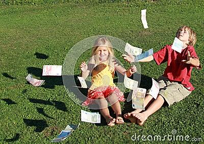 Barefoot boy and girl throwing money