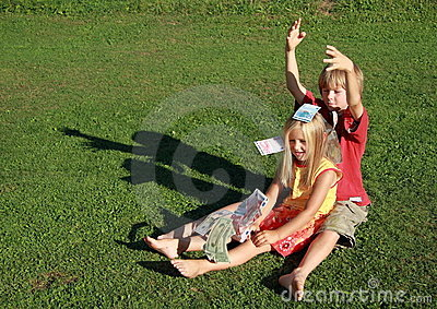Barefoot boy and girl throwing money
