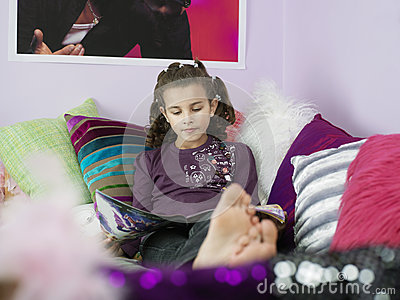 Barefoot Girl Reading Magazine In Bed Stock Photo Image