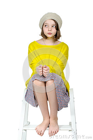 Free Barefoot Girl Sitting On A Stepladder With A Mysterious Look. Stock Images - 81884144
