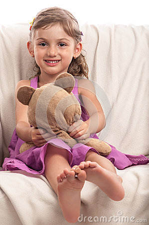 Barefoot girl with toy