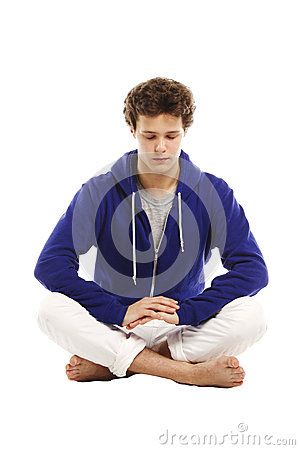 Barefoot handsome man in yoga position