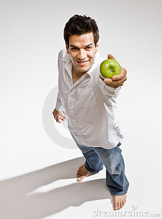 Free Barefoot Man Holding Fresh Green Apple Stock Photo - 6601380