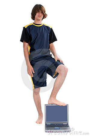 Barefoot teen Boy Standing with Laptop Computer Over White