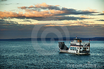 Barge or ferry on a cloudy evening