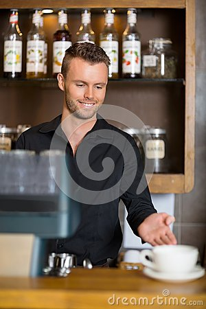 Barista Gesturing At Counter In Coffeeshop