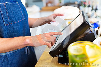 Barista using cash counter Stock Photo