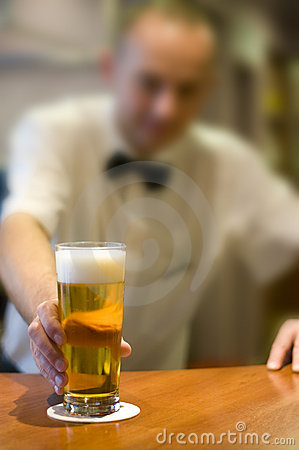 Barman serving beer