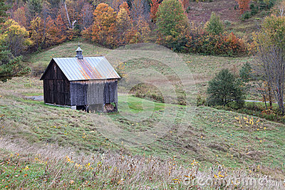 Barn in field in autumn