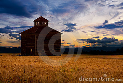 Barn silhouetted at sunset