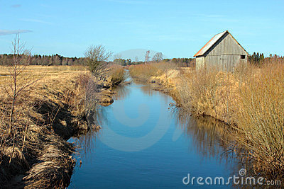 A barn by the water canal