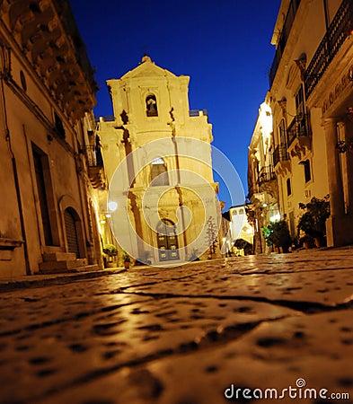 Baroque church lit at night