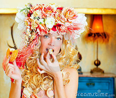 Baroque fashion blonde woman eating dona