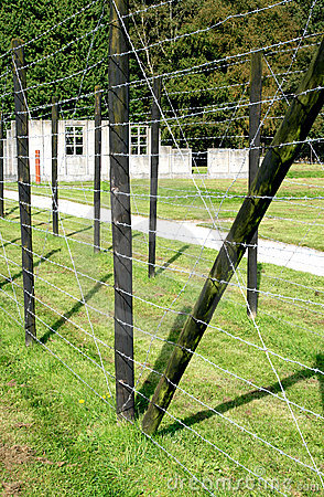 Barrack behind barbed wire in a concentration camp Editorial Stock Image