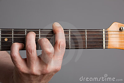 Barre chord on electric guitar
