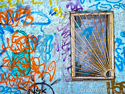 Barred window, wall with graffity
