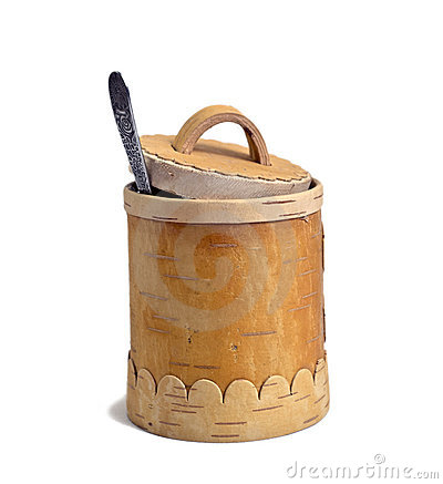 Barrel of the honey with spoon on white background