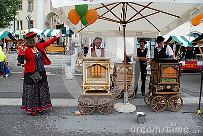 Barrel organ players and puppet miniature Editorial Photography