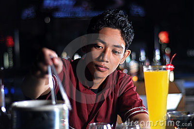 Bartender making drink