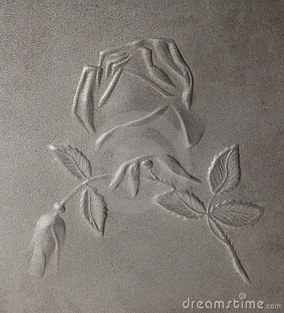 Bas-relief depicting roses on metal