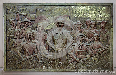 Bas-relief of Ho Chi Minh with troops and workers. Editorial Stock Image