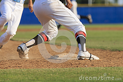 Baseball Action - Feet first slide into base