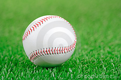 Baseball ball on a green grass
