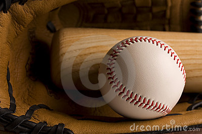 Baseball and baseball bat in glove