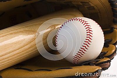 Baseball and baseball bat in glove