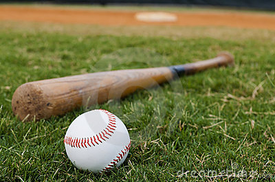 Baseball and Bat on Field