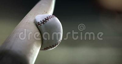 Baseball Bat hitting ball, super slow motion. Baseball bat hits the ball in slow motion, close-up, you can see how deformation ball and breaking seam thread