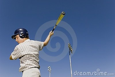 Baseball batter warming up in before match