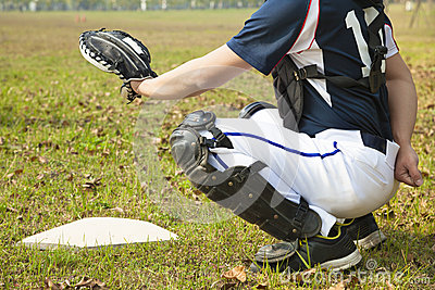 Baseball catcher ready to catch ball at  home plate