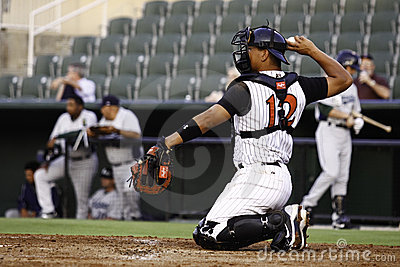 Baseball Catcher Throwing Ball Editorial Photo