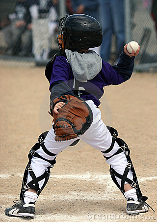 Baseball catcher throwing ball