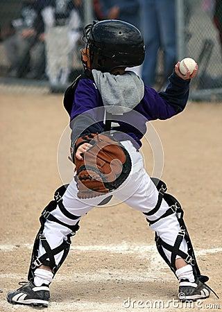 Baseball catcher throwing ball