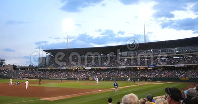 Baseball Game in Stadium, Crowd POV Point of View Shot. Crowd POV shot of a baseball game in a stadium at dusk stock video footage