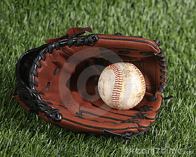 Baseball and glove on the grass