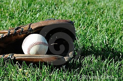 Baseball in Glove On Grass