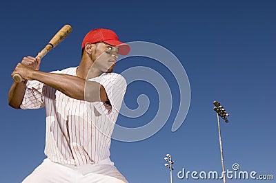 Baseball Player Preparing To Hit A Ball